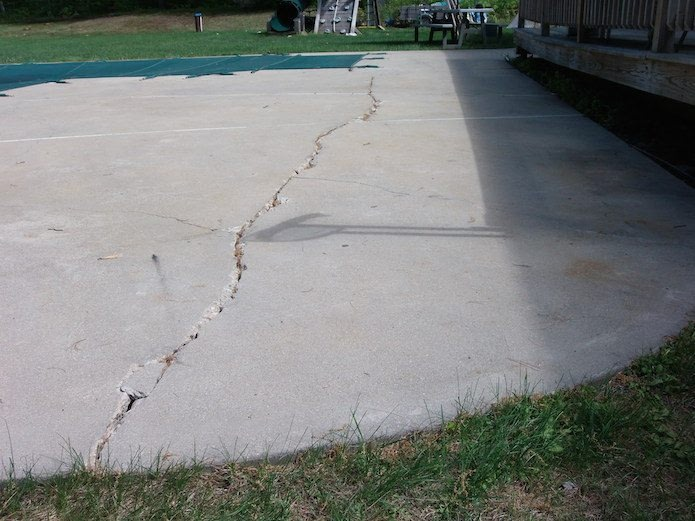 cracked concrete pool deck